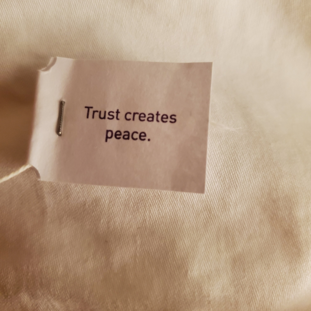 Trust creates peace. Message on a teabag.